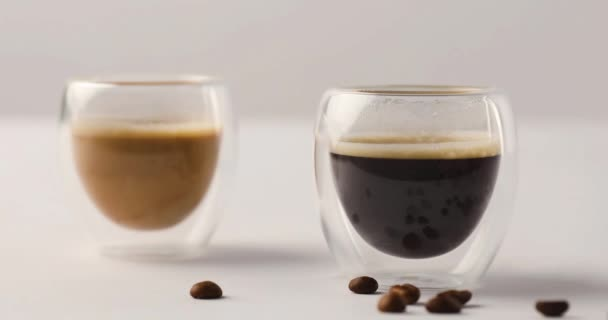 Double Walled Glass cups with coffee on white background