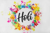 circle frame of colorful traditional paint with Holi sign, isolated on white, Hindu spring festival of colours