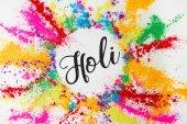Fényképek színes hagyományos por, elszigetelt fehér, Hindu tavaszi fesztivál Holi előjellel kör