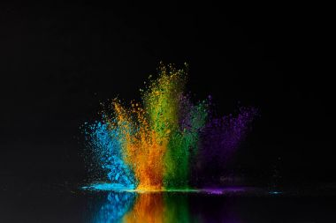 colorful holi powder explosion on black, Hindu spring festival