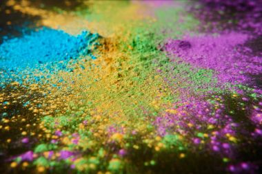 colorful holi powder on black, traditional Indian festival of colours