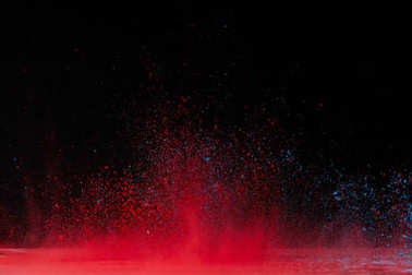red holi powder explosion on black, traditional festival of colours