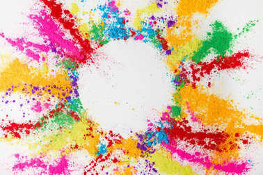 circle frame of multicolored traditional powder, isolated on white, holi festival