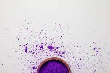 Top view of purple holi paint in bowl isolated on white, Hindu spring festival stock vector