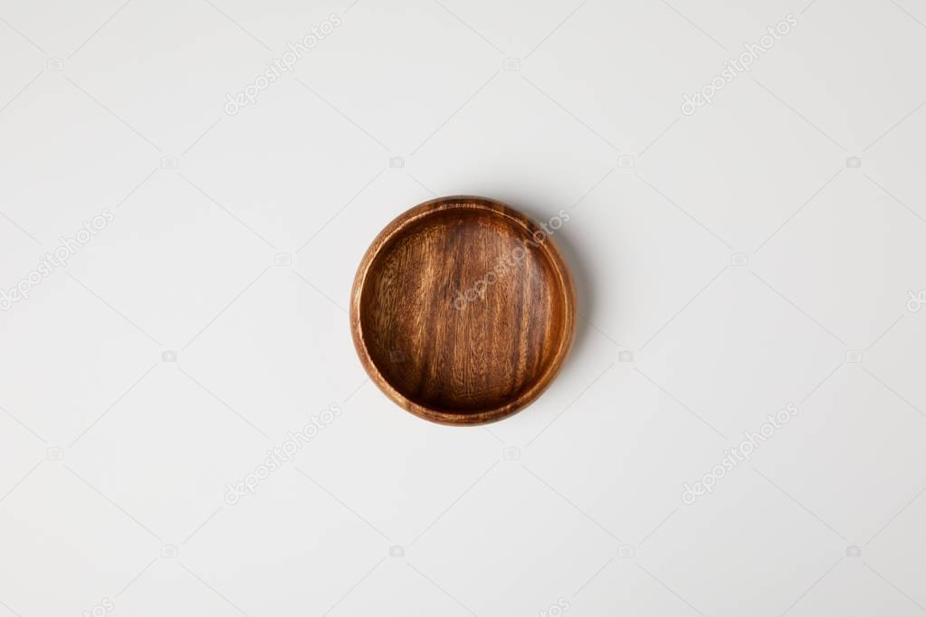 top view of wooden bowl isolated on white
