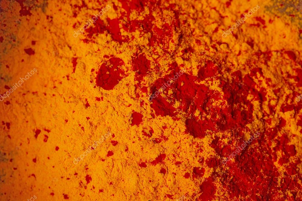 top view of orange and red holi powder, traditional Indian festival of colours