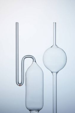 various empty chemistry glassware on grey