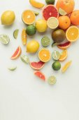 Fotografie Whole and sliced citruses isolated on white background