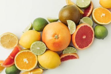 Pile of citruses whole and pieces isolated on white background