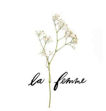 small white flowers on twig with LE FEMME lettering isolated on white