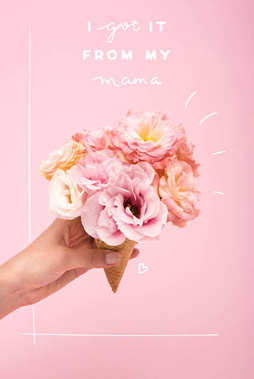 mothers day greting card with person holding waffle cone with beautiful blooming flowers isolated on pink