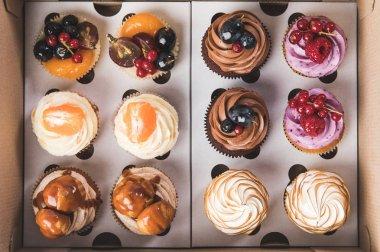 top view of sweet cupcakes in cardboard box