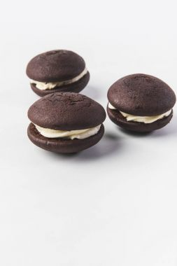 close up view of chocolate cookies with cream isolated on white