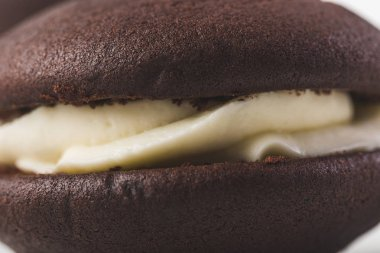 close up view of chocolate cookie with cream