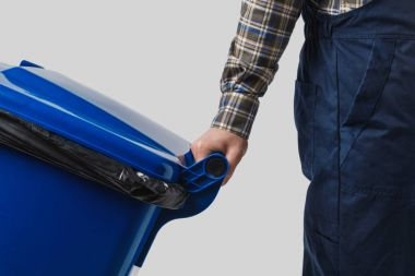 partial view of cleaner with trash bin isolated on grey