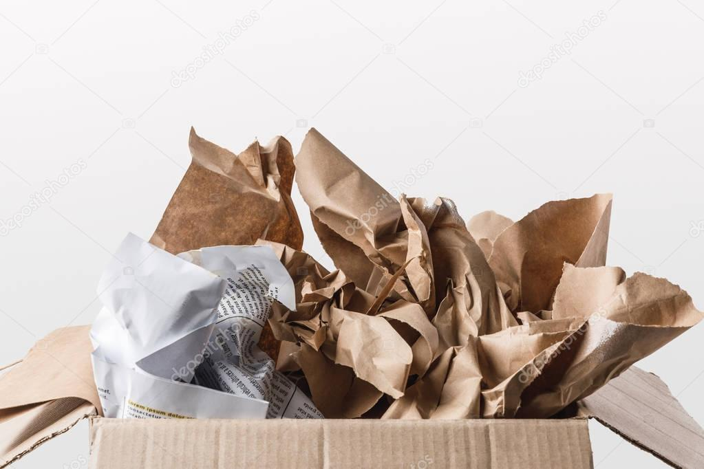 close up view of cardboard box with papers inside isolated on white