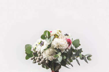 close up view of beautiful bridal bouquet isolated on grey