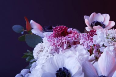 different white and pink flowers on dark
