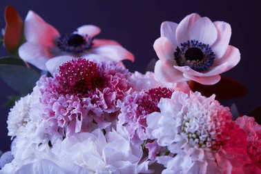 bouquet of different white and pink flowers on dark