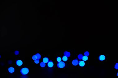 abstract blue bokeh on dark background