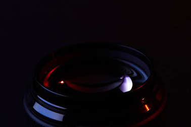 reflecting optical lens on dark surface