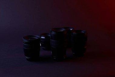 black camera lenses on dark surface