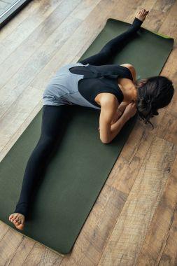 high angle view of girl practicing yoga and doing split