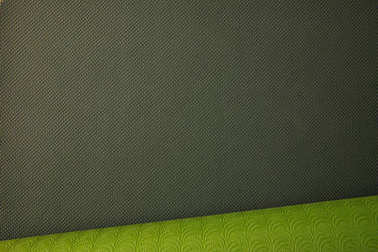 top view of green rolled yoga mat