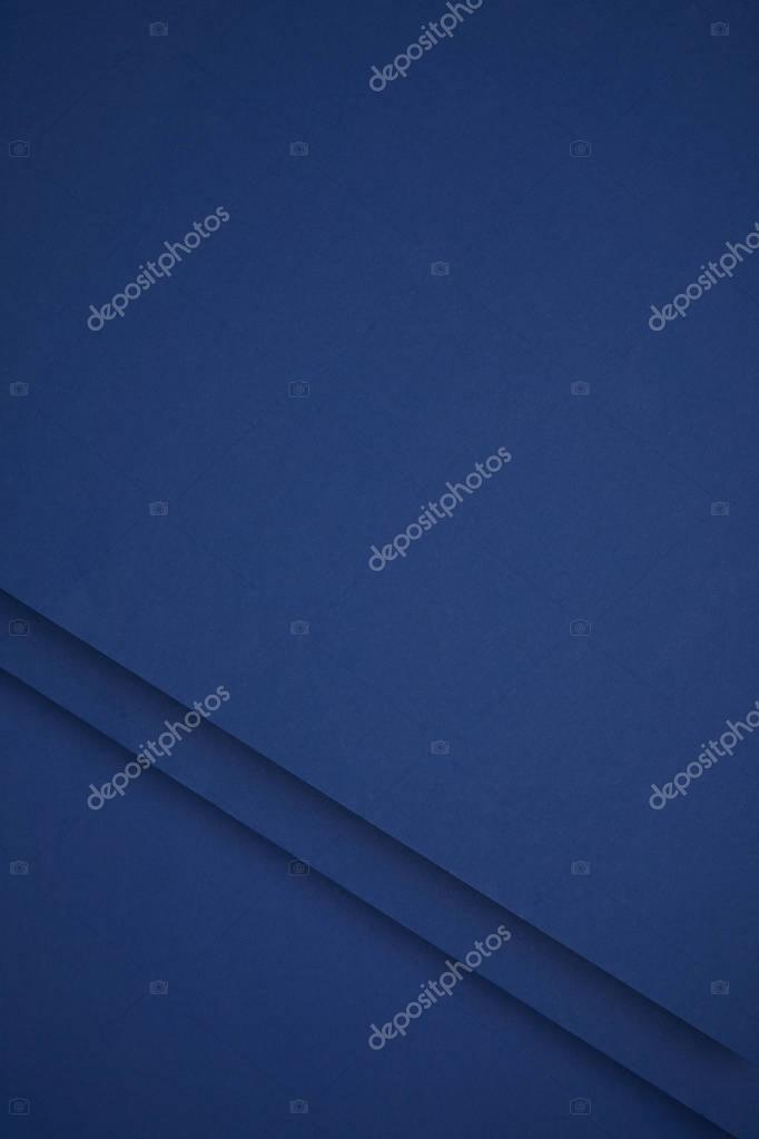 dark blue abstract background from colored paper