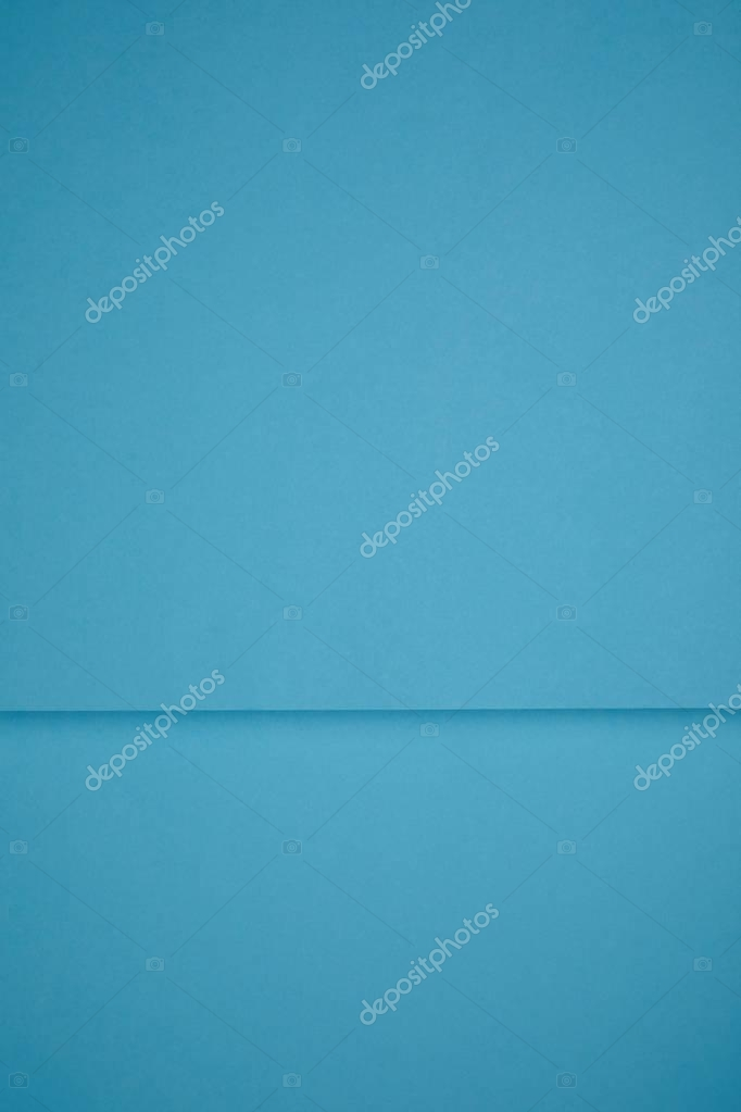 bright blue abstract background from colored paper
