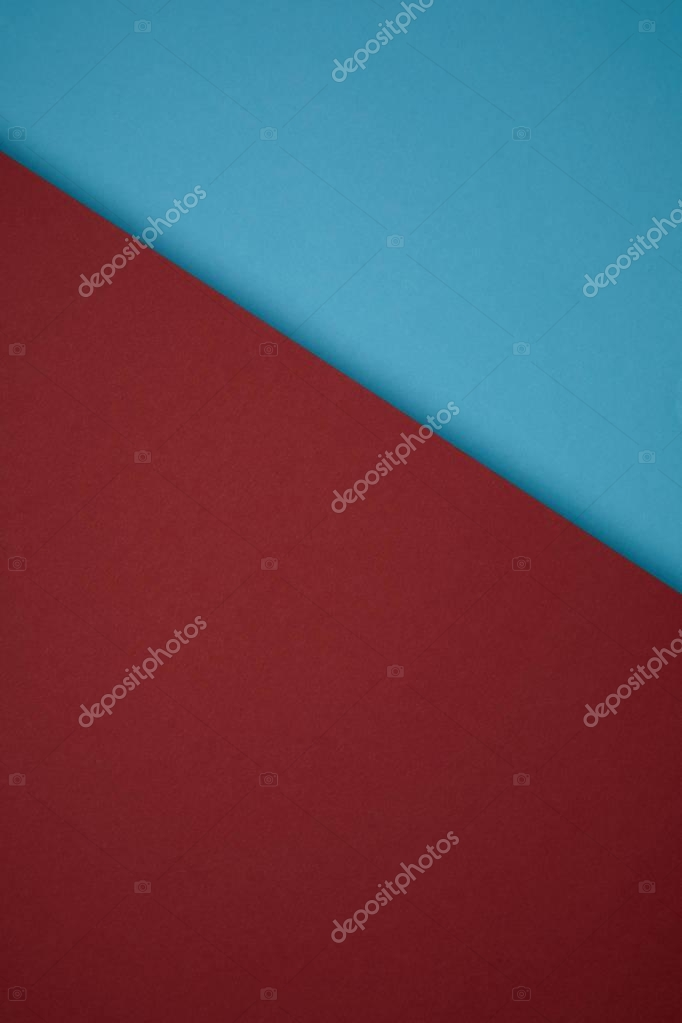 close up view of creative background from red and blue colored paper