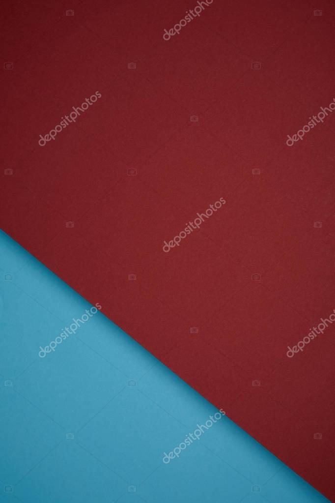 creative geometric background from red and blue colored paper