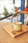 Photo Mug with hot cocoa served with walnuts and orange peel