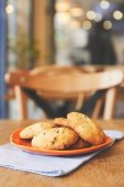 Chocolate chip cookies on plate in cafe