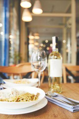 Italian cuisine dish spaghetti with pesto on restaurant table