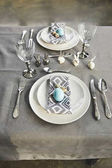 Fotografie high angle view of painted blue chicken eggs on plates on table