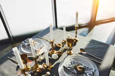 high angle view of decorated easter table with sunlight
