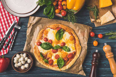 top view of appetizing tasty pizza on kitchen table