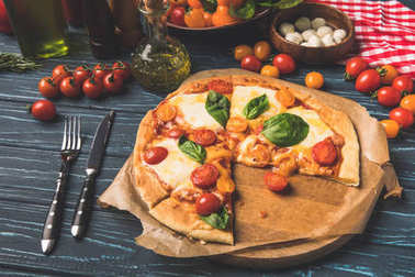 appetizing tasty pizza on cutting board on table