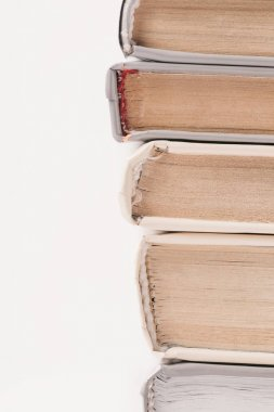 Cropped image of stack of books isolated on white