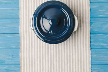 top view of pan on napkin on blue wooden table