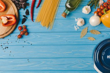 top view of ingredients for cooking pasta on blue table