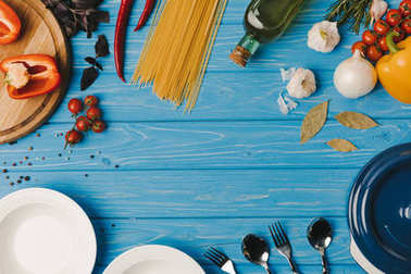 top view of ingredients for cooking on blue table