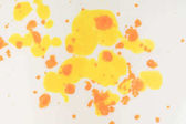 abstract background with yellow and orange stains