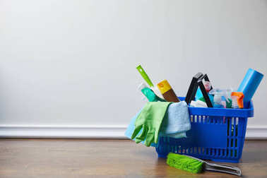 domestic supplies for spring cleaning in basket on floor