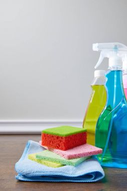 bottles with antiseptic liquids and rags for spring cleaning
