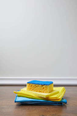 blue and yellow sponge and rags for spring cleaning