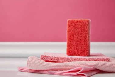 pink washing sponge and rags for spring cleaning