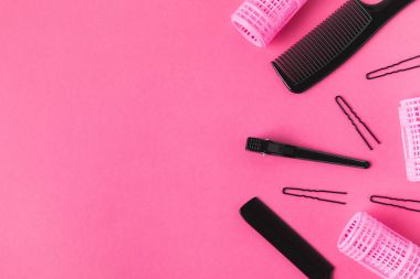 top view of hairdressing tools, isolated on pink