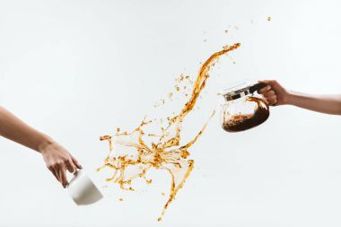 Cropped view of hands splashing hot coffee from cup and glass pot, isolated on white stock vector